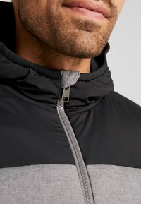 Kjus - BLACKCOMB STRETCH HOODED JKT - Veste de ski - steel greymelange/black - 4