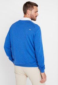 Kjus - MEN KIRK V-NECK  - Pullover - pacific blue melange - 2