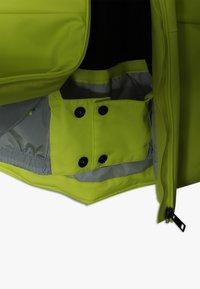 Kjus - BOYS SPEED READER JACKET - Ski jacket - citrus yellow/south black - 3