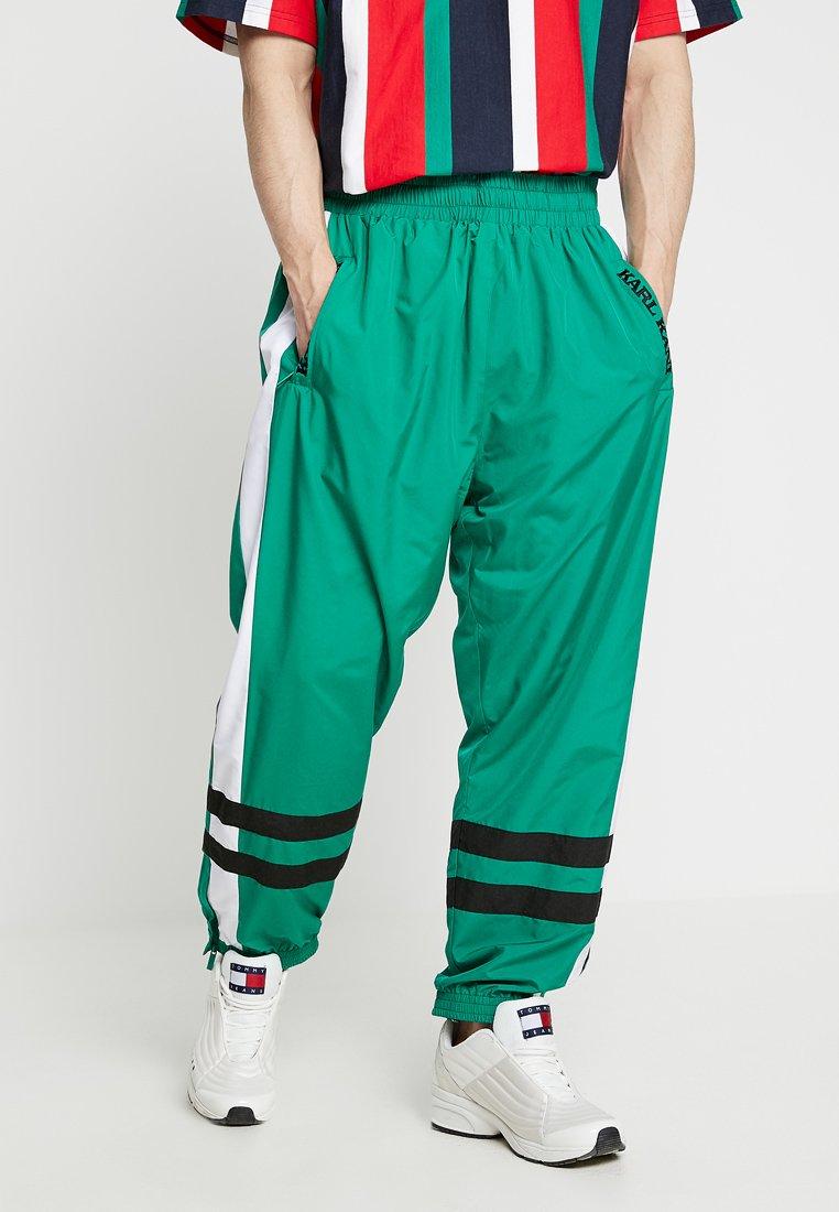 Karl Kani - RETRO TRACKPANTS - Pantalones deportivos - green/white/black