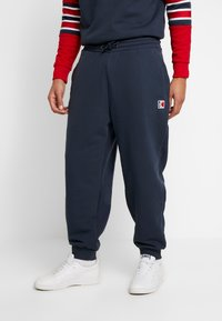 Karl Kani - RETRO TRACKPANTS - Tracksuit bottoms - navy - 0