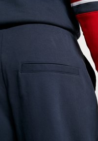 Karl Kani - RETRO TRACKPANTS - Tracksuit bottoms - navy - 5