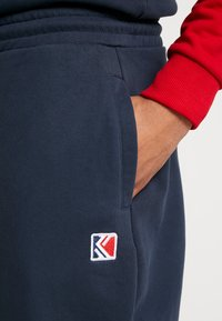 Karl Kani - RETRO TRACKPANTS - Tracksuit bottoms - navy - 3