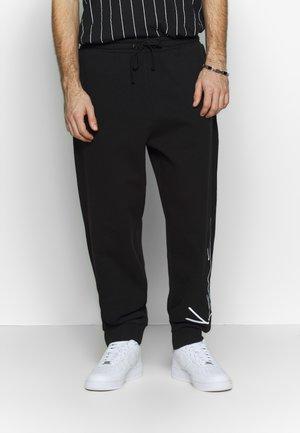 SIGNATURE RETRO - Jogginghose - black/white