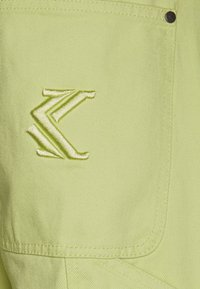 Karl Kani - PANTS  - Relaxed fit jeans - yellow - 4