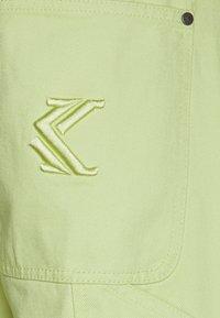 Karl Kani - PANTS  - Džíny Relaxed Fit - yellow - 2