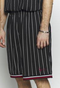 Karl Kani - SIGNATURE - Tracksuit bottoms - black/white/red - 5
