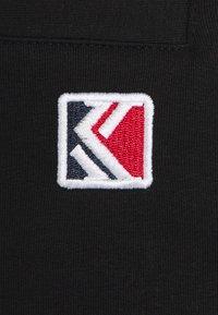 Karl Kani - SIGNATURE  - Tracksuit bottoms - black - 2
