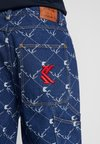 Karl Kani - BAGGY - Jeans Relaxed Fit - blue/white