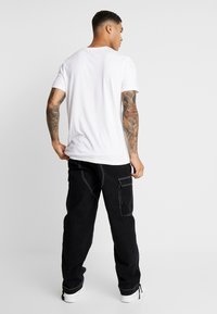 Karl Kani - BAGGY - Jeans relaxed fit - black - 2