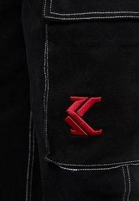 Karl Kani - BAGGY - Vaqueros boyfriend - black - 6