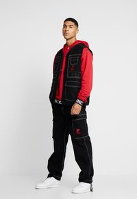 Karl Kani - BAGGY - Jeans relaxed fit - black - 1