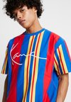 Karl Kani - SIGNATURE STRIPE TEE - T-Shirt print - red/blue/yellow