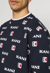 Karl Kani - Mikina - navy/white/red - 5