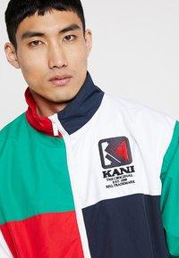 Karl Kani - TRACKJACKET - Trainingsvest - navy/green/red/white - 3