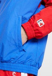 Karl Kani - SIGNATURE TRACKJACKET - Lehká bunda - blue/navy/red/white - 5