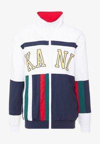 Karl Kani - COLLEGE BLOCK TRACKJACKET - Träningsjacka - white/navy/red/green - 4