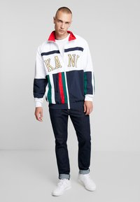Karl Kani - COLLEGE BLOCK TRACKJACKET - Träningsjacka - white/navy/red/green - 1