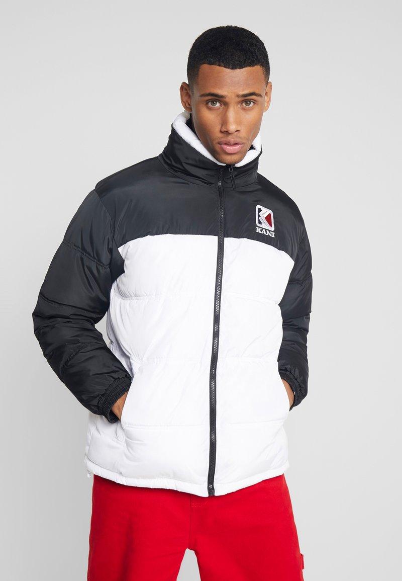 Karl Kani - RETRO REVERSIBLE PUFFER JACKET - Winter jacket - white/black