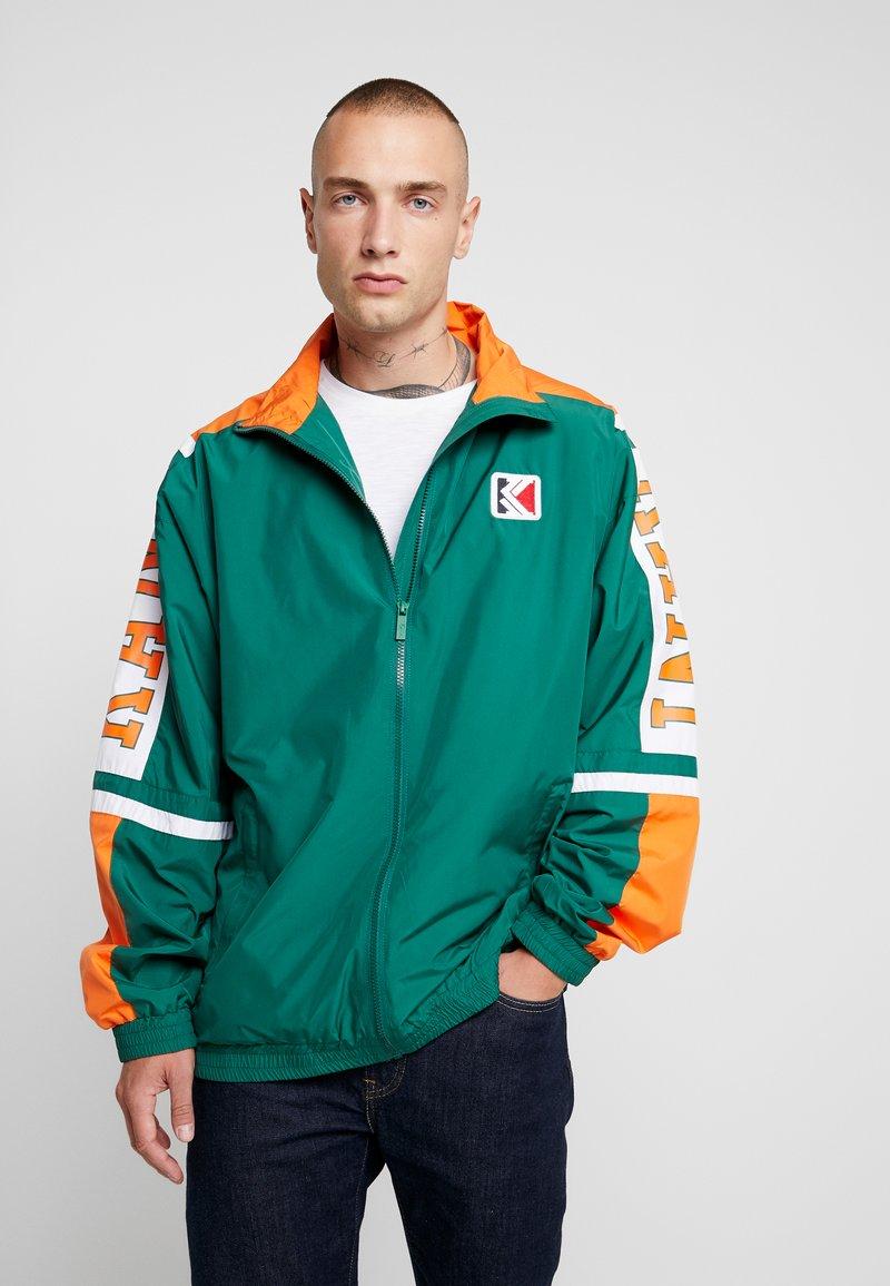Karl Kani - COLLEGE TRACKJACKET - Trainingsjacke - green/orange/white