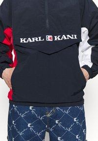 Karl Kani - RETRO BLOCK - Windbreaker - navy/red/white - 5