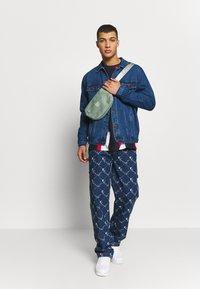 Karl Kani - JACKET - Denim jacket - blue - 1