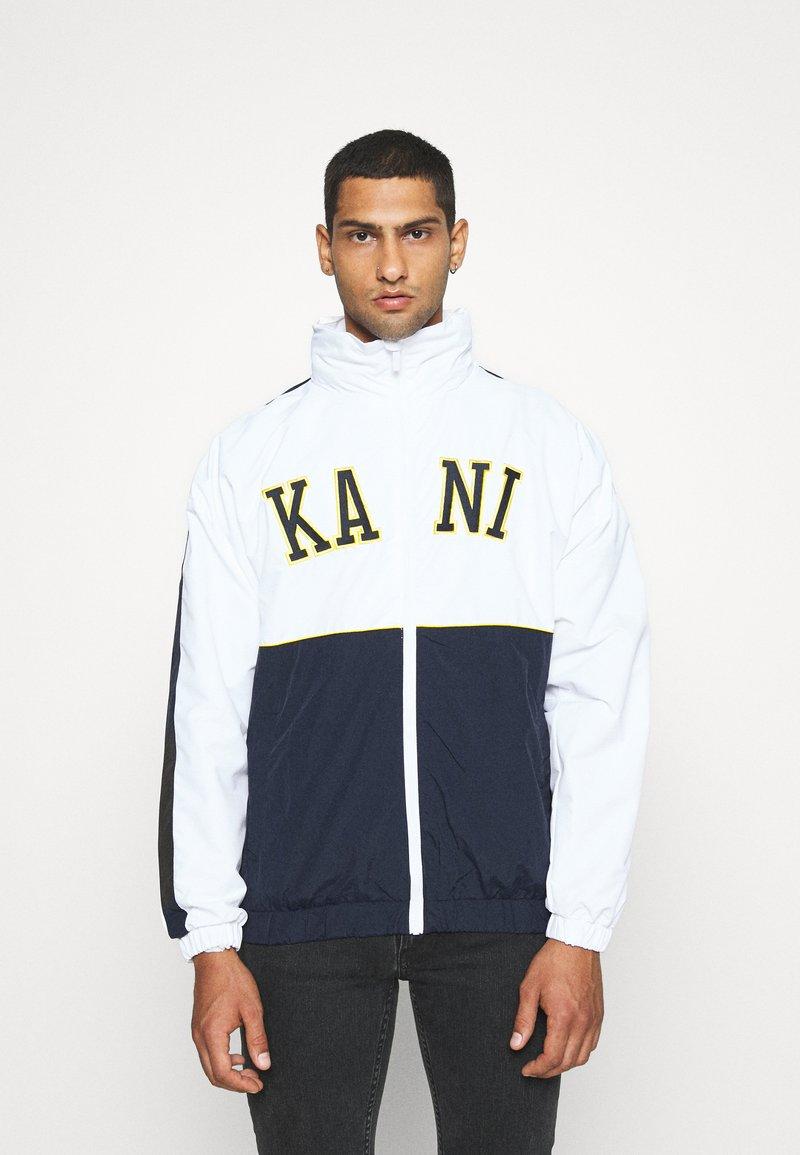 Karl Kani - COLLEGE BLOCK WINDRUNNER - Lehká bunda - white