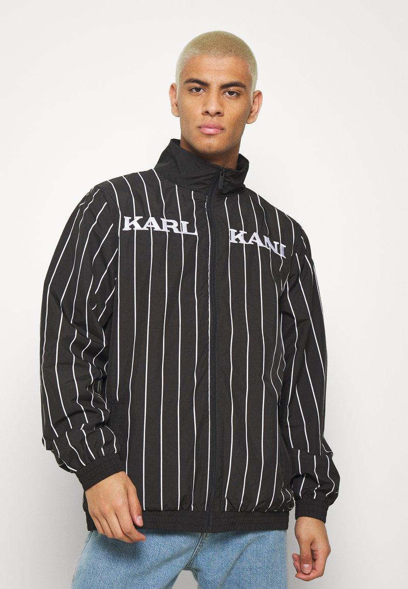 Karl Kani - RETRO PINSTRIPE TRACK JACKET - Giacca leggera - black