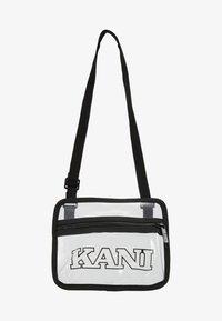 Karl Kani - COLLEGE MESSENGER BAG - Taška spříčným popruhem - transparent/black - 6