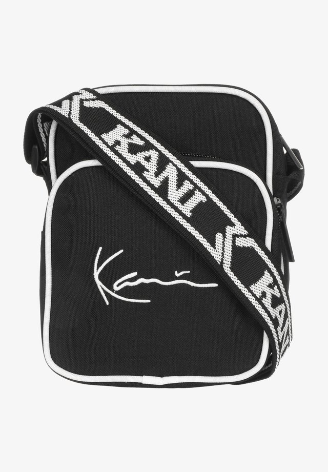 SIGNATURE - Sac bandoulière - black/white