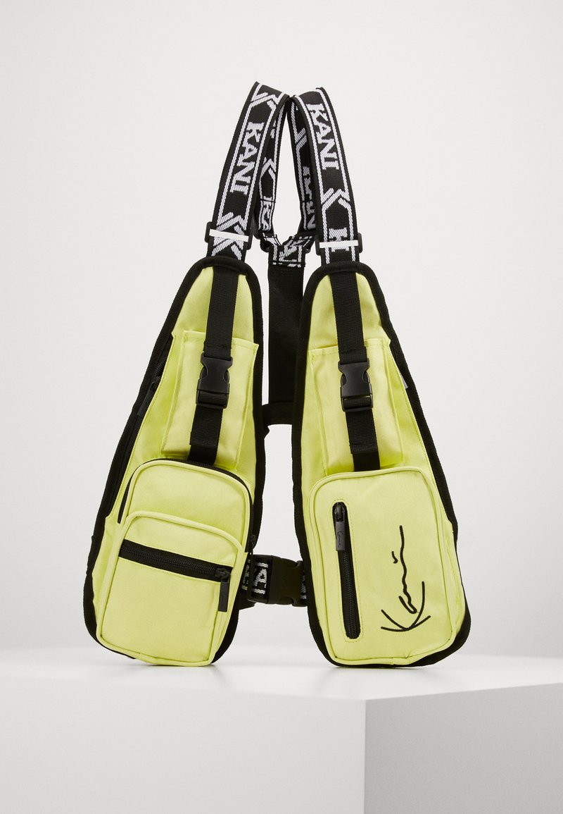 Karl Kani - TAPE UTILITY VEST BAG  - Ledvinka - yellow