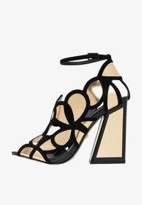 Kat Maconie - VIVI - Højhælede sandaletter / Højhælede sandaler - gold/black - 1