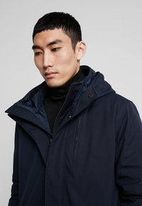 Knowledge Cotton Apparel - LONG SOFT SHELL JACKET  - Winter coat - total eclipse - 5