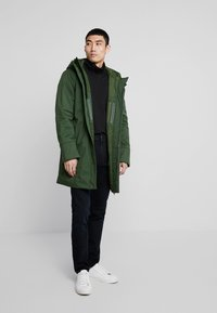 Knowledge Cotton Apparel - LONG SOFT SHELL JACKET  - Talvitakki - green forest - 1