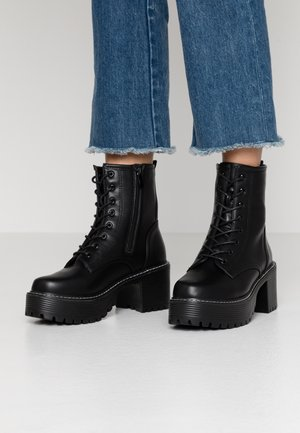 VEGAN DL3 - Platform ankle boots - black