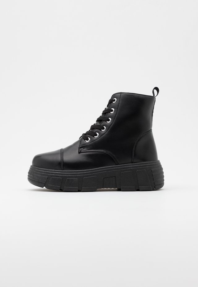 VEGAN - Kotníkové boty na platformě - black
