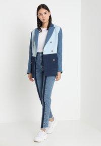 Ksenia Schnaider - SLIM JEANS WITH FRONT STRIPES - Slim fit jeans - medium blue - 1