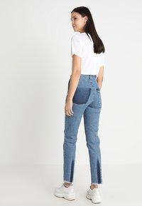 Ksenia Schnaider - SLIM JEANS WITH FRONT STRIPES - Slim fit jeans - medium blue - 2