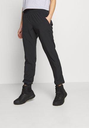 NORA PANTS - Teplákové kalhoty - black