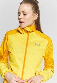 KariTraa - NORA JACKET - Sports jacket - gold - 3