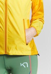 KariTraa - NORA JACKET - Sports jacket - gold - 5