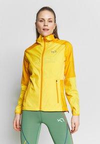 KariTraa - NORA JACKET - Sports jacket - gold - 0