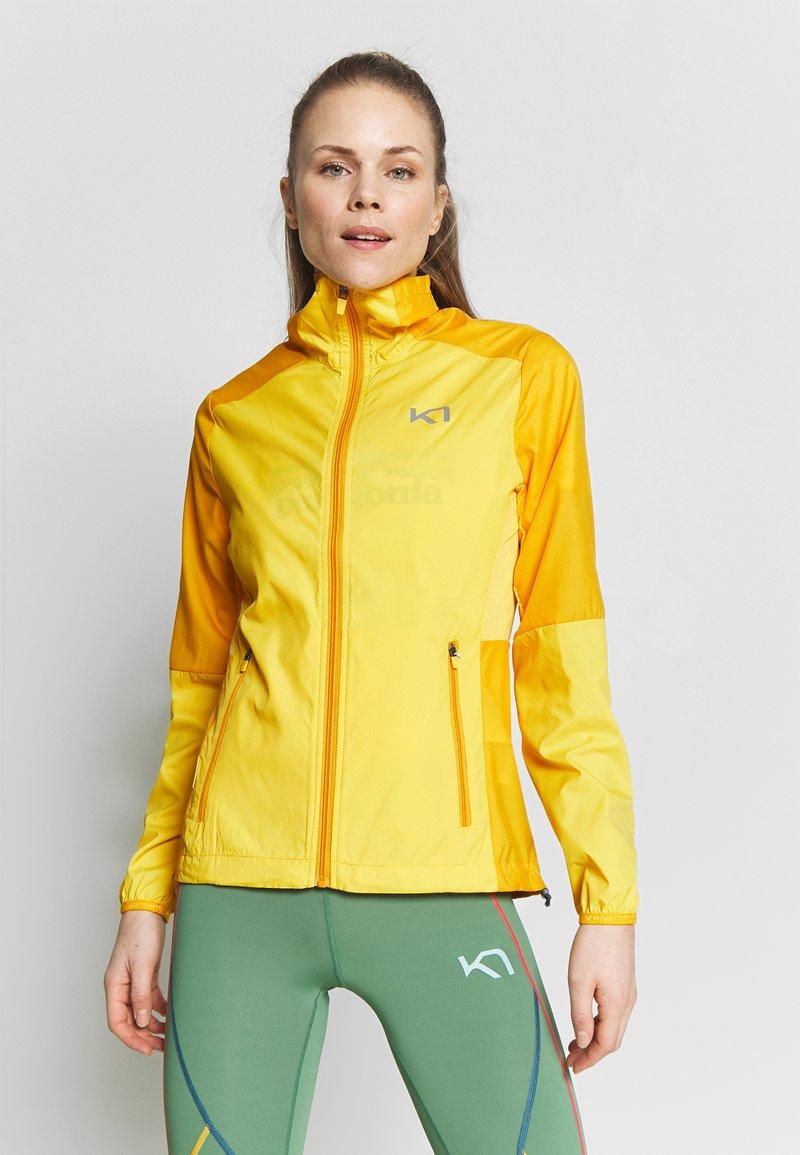 KariTraa - NORA JACKET - Sports jacket - gold