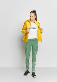 KariTraa - NORA JACKET - Sports jacket - gold - 1