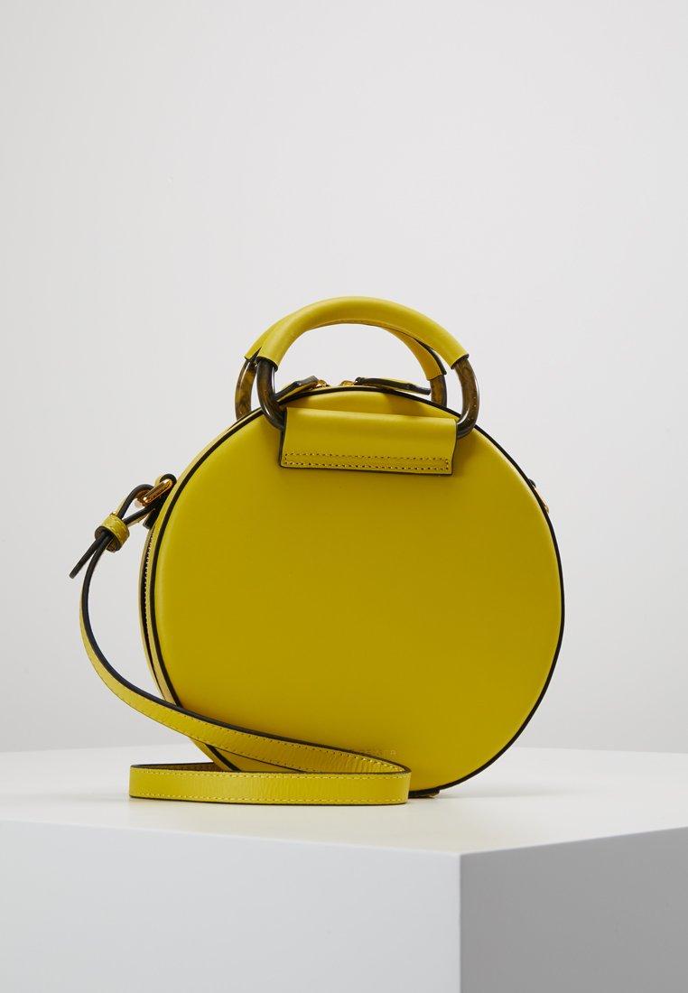 Kurt Geiger London - HARRIET CROSSBODY - Across body bag - yellow