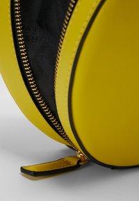 Kurt Geiger London - HARRIET CROSSBODY - Across body bag - yellow - 6