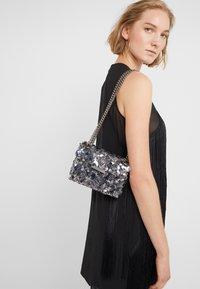 Kurt Geiger London - EXCLUSIVE MINI KENS BAG - Across body bag - silver - 1