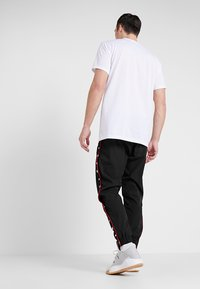 K1X - DANDY DIARY TEARAWAY PANTS - Jogginghose - black - 2