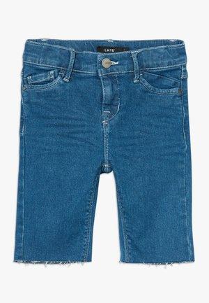 BIKER - Denim shorts - medium blue denim