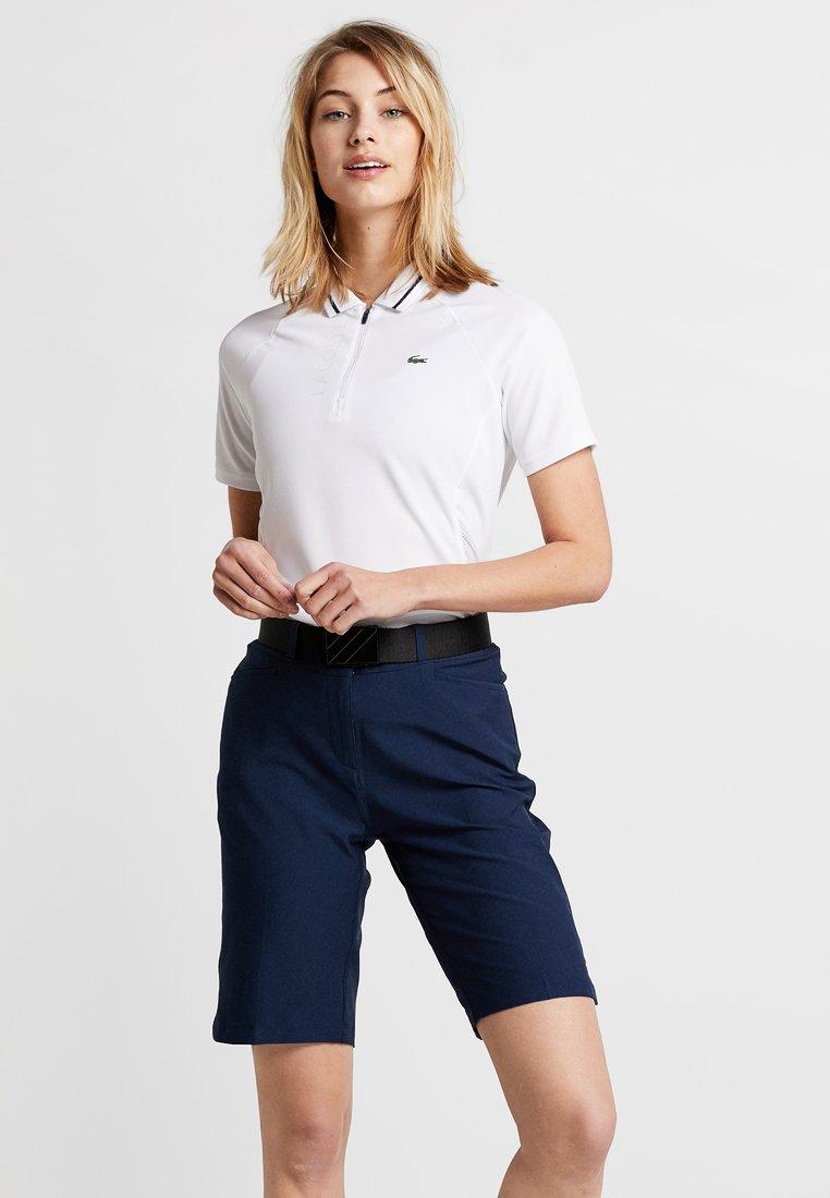Lacoste Sport - GOLF CLASSIC ZIP - Sports shirt - white/navy blue